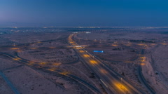 Highway roads with traffic night to day timelapse in a big city from Ajman to Stock Footage