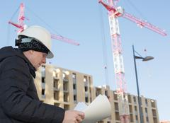 An engineer on a construction site with cranes Stock Photos
