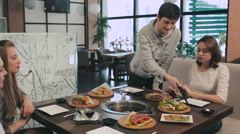 Guy helping his friends to fry raw food on grill - stock footage