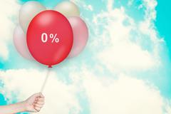 Hand Holding zero percent Balloon Stock Photos