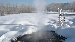 Chink with hot water and snow field in Kamchatka Stock Footage