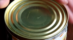 Opening canned food Stock Footage