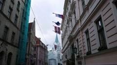 Latvian, UK, EU and russian national flags at Riga old town, Riga, Latvia Stock Footage