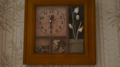 Old Watch With Pictures Hanging on Wall With Wallpaper Sticked - stock footage