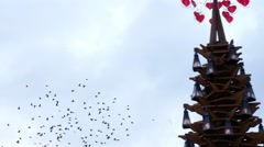 Many flying birds under Christmas market in Riga's Old Town, Latvia Stock Footage