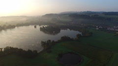 "Aerial Footage: Sunrise over lake ""Mauensee"" in Switzerland during fall, 4K, UHD Stock Footage"