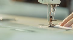 The woman in the factory sewing on the machine Stock Footage