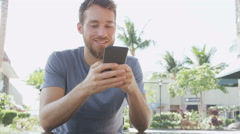 Man Using Mobile Smart phone At Sidewalk Cafe Text Messaging Stock Footage