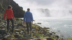 Couple Walking At Godafoss Waterfall - Active People Healthy Lifestyle Stock Footage