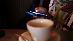 Close up of hands woman using her cell phone in restaurant, cafe Stock Footage