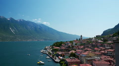 Aerial view to Limone Sul Garda pier in the Garda lake, Northern Italy Stock Footage