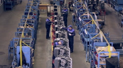 Conveyor with engines. Worker assembling motors, engines. view at factory Stock Footage