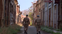 Two British United Nations UN soldiers patrol the peace in Cyprus Stock Footage