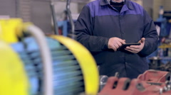 Industrial worker with tablet working in power plant Stock Footage
