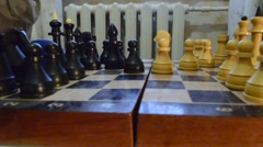 Hand Moves the Black Pieces on a Chessboard Making His Move Stock Footage