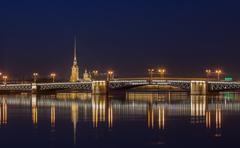 Neva river, Peter and Paul Cathedral, Palace bridge at night - stock photo