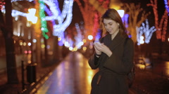 The lovely girl prints the message to the boyfriend Stock Footage