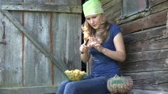 Woman cleans carefully forest chanterelle  Stock Footage