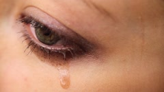 Close-up of girls tearful eye. - stock footage