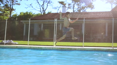 Child running and jumping inside swimming pool  Stock Footage