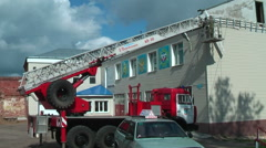 Builders reconstruct building by fire truck Stock Footage