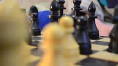 Black Pieces on the Chessboard Move by Elderly Man Hands Close up - stock footage