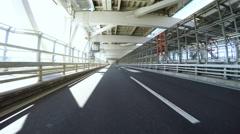 Driver POV departing Tokyo over the Rainbow Bridge Stock Footage