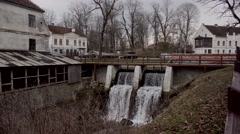 Historical buildings and waterfall in old town of Kuldiga, Latvia Stock Footage