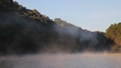 Fog on the water in morning at Pang-ung, Pine forest in Mae Hong Son,Thailand Stock Footage