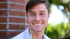 Young man making video diary selfie outdoor in the park Stock Footage