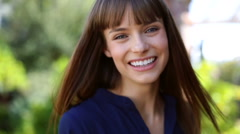 Young female making video diary selfie outdoor in the park Stock Footage