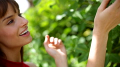 Young female making video diary selfie in the park Stock Footage