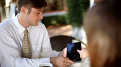 Business team using tablet technology for outdoor meeting Stock Footage