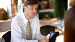 Young male female business people using tablet technology - stock footage