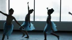 Portrait of a group of young girls ballet dancing in silhouette Stock Footage