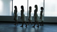 Silhouette of young multi ethnic girls barefoot in dance studio - stock footage