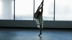 Girl performing contemporary ballet in silhouette in dance studio - stock footage