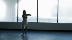 Caucasian young girl freestyle dancing in silhouette - stock footage