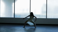 Silhouette of young Caucasian girl barefoot in dance studio - stock footage