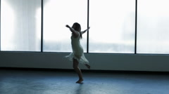 Caucasian young girl freestyle dancing in silhouette Stock Footage