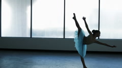 Young ballet dancer in dance school in silhouette Stock Footage