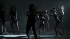 Multi ethnic girls in black leotard using powder in silhouette freestyle dancing Stock Footage