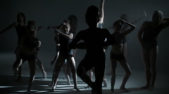 Group of barefoot multi ethnic girls in black leotards performing modern dance Stock Footage