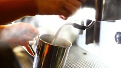 barista pouring hot water in a metallic mug. - stock footage