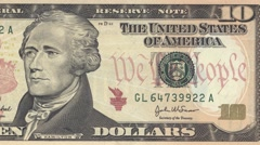Ten dollar note obverse dolly shot from right to left showing 10 symbols 4k Stock Footage