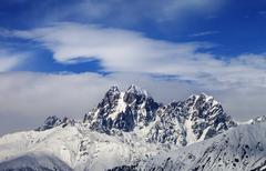 Mounts Ushba and Chatyn and blue sky with clouds Stock Photos