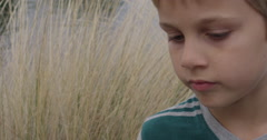 Slow Motion Thinking Young Boy Turns From One Side to the Other Stock Footage