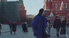 Young beautiful woman in stylish mink coat on a background of a winter street Stock Footage