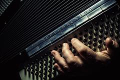 Hand on Accordion While Playing - stock photo
