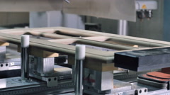Worker blow the wood shavings away by air pistol and take the detail from the - stock footage